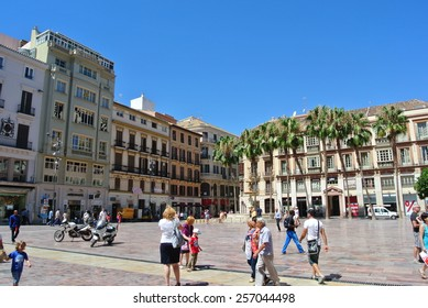 MALAGA, SPAIN - JULY 1, 2014: One of the major and most pleasant squares in the center of Malaga - Plaza de la Merced, at the beginning of summer.
