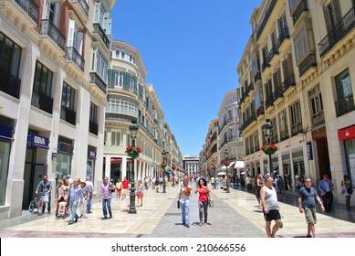 MALAGA, SPAIN - JULY 1: The main pedestrian zone on July 1, 2014 in Malaga, Spain. The beginning of summer has brought about a large number of tourists to this Andalusian seaside resort.