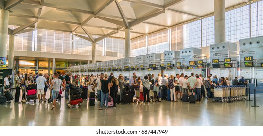 Malaga, Spain, July 2 2017: travelors checking in at the counters of Malaga Airport
