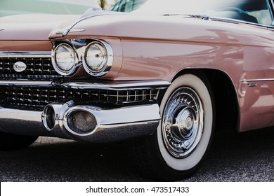 MALAGA, SPAIN - JULY 30, 2016: Detail of classic american Cadillac Deville. Headlamp close up.