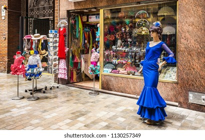 Malaga, Spain - June 16, 2018: The shop of national Souvenirs in Malaga, Spain