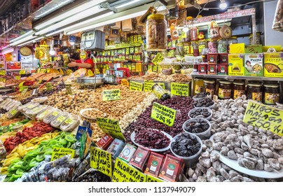 Malaga, Spain - June 16, 2018: Shop inside Malaga's Atarazanas market with a variety of nuts and dry fruits.
