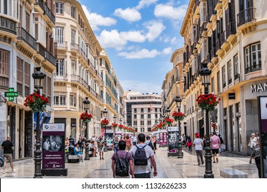 MALAGA, SPAIN - JUNE 2, 2018: Pedestrian Larios Street (Calle Marques de Larios, 1891) - major shopping street, one of the most important in Spain, together with Plaza Constitucion.