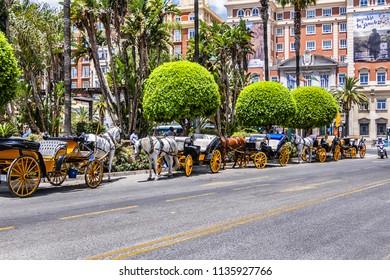 MALAGA, SPAIN - JUNE 2, 2018: Marina Square (Plaza de la Marina) - main square of Malaga, was designed in XIX century, located in front of main entrance of Port.