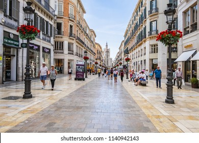 MALAGA, SPAIN - JUNE 2, 2018: Pedestrian Larios Street (Calle Marques de Larios, 1891) - major shopping street, one of the most important in Spain, together with Plaza Constitution.
