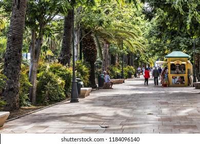 MALAGA, SPAIN - JUNE 2, 2018: Parque de Malaga is also known as Parque de la Alameda or simply - El Parque (The park). Rectangularly shaped park has over 100 years of history.