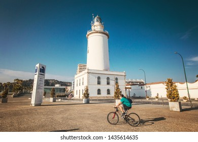 MALAGA, SPAIN - June 2019: Malaga Lighthouse, La Farola on sunny summer day, Malaga, Andalusia, Spain