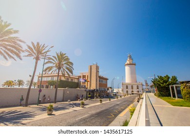 MALAGA, SPAIN - June 2019: Malaga Lighthouse view, La Farola, Malagueta beach, Andalusia, Spain