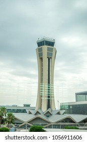 Malaga, Spain - June 25, 2017 :  The beautiful control tower at the scenic Malaga airport with a hill behind, Malaga, Spain, Europe