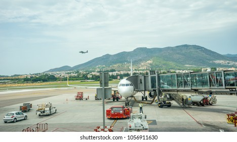 Malaga, Spain - June 25, 2017 :  An aeroplane being prepared for departure at the scenic Malaga airport with a hill behind, Malaga, Spain, Europe