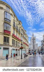 MALAGA, SPAIN - JUNE 4, 2018: Pedestrian Larios Street (Calle Marques de Larios, 1891) - major shopping street, one of the most important in Spain, together with Plaza Constitution.