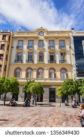 MALAGA, SPAIN - JUNE 6, 2018: Plaza de la Constitution is a public thoroughfare in center of city of Malaga. It is old Plaza Mayor (XV century), located in heart of historic center of Malaga city.