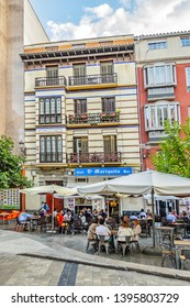 MALAGA, SPAIN - JUNE 6, 2018: Uncibay Square (Plaza de Uncibay) - a little plaza in center of Malaga with more shops, Bars, Fountain, artworks and little cartoonish statues.