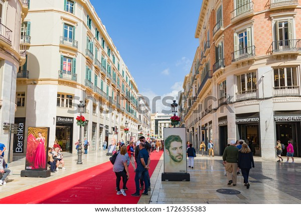 MALAGA, SPAIN, March – 2019: People walking on the red carpet laid out on the Calle Alcazabilla during the Malaga Film Festival, one of the most important events of Spanish cinema.