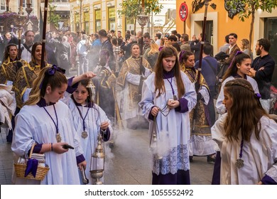 Malaga, Spain - March 26, 2018. Children participating in the procession in the Holy Week in a Spanish city