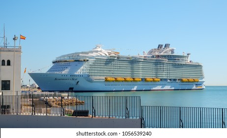 Malaga, Spain - March 27, 2018. Luxury cruise ship Symphony of the seas anchored in the harbor of Malaga