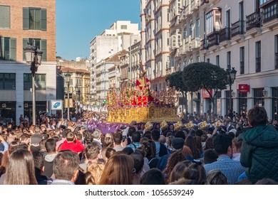 Malaga, Spain - March 27, 2018. People participating in the procession in the Holy Week in a Spanish city