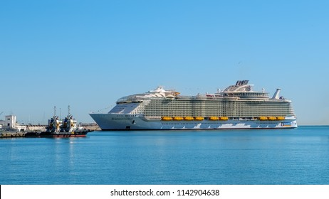 Malaga, Spain - March 27, 2018. Luxury cruise ship Symphony of the seas, docked at the port of Malaga city, Costa del Sol, Malaga Province, Andalucia, Spain