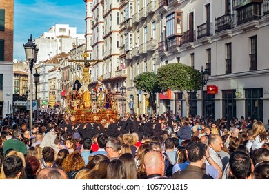 Malaga, Spain - March 28, 2018. Catholic religious procession in the Holy Week in a Spanish street city