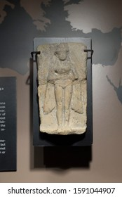 Malaga, Spain - March 2nd, 2019: Mesopotamian tablet relief depicting Inanna, goddess associated with love, sex, war. Terracotta, 18th BC. ifergan Collection