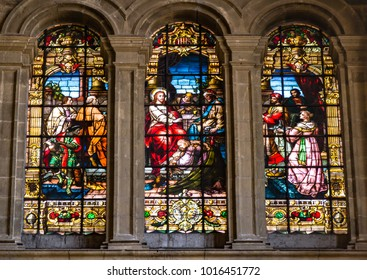 Malaga, Spain - March 5, 2017: Religious scene of the Anointing of Jesus on stained glass windows in the Cathedral of Malaga.