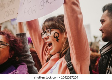 MALAGA, SPAIN - MARCH 8, 2018: Thousands of women take part in the Feminist Strike on the Women Day in the city center of Malaga, Spain, on March 8th 2018.