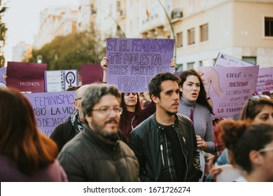 Malaga, Spain - March 8th, 2020: People celebrating 8m woman day with banners and placards, during feminist strike in Malaga, Spain, on March 8th, 2020.