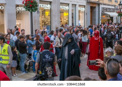 Malaga, Spain - May 05, 2018. Members of the 501st Legion Spanish Garrison dressed as Darth Sidious from the movie saga Star Wars, perform along the walk Marques de Larios Malaga, Spain