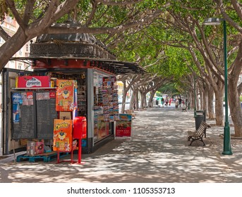 MALAGA, SPAIN - MAY 11, 2018 : Small newsstand in the street of Malaga, Spain,