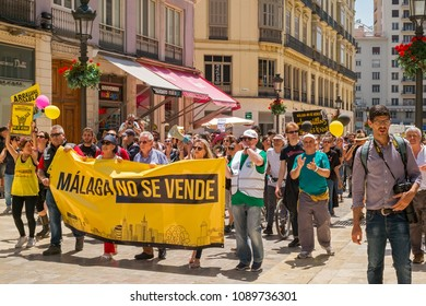 Malaga, Spain - May 12, 2018. People members of the Malaga No Se Vende platform, manifesting on the Marques de Larios pedestrian, in the historic center of Malaga, Spain
