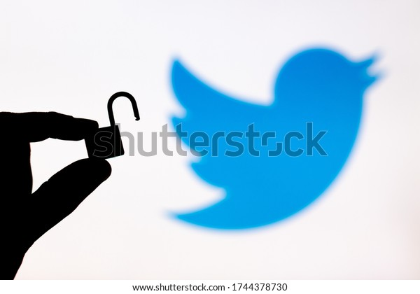 Malaga, Spain - May 18th, 2020: Twitter Security. Holding an unlocked padlock besides a Twitter logo