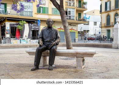 Malaga, Spain - May 24, 2019: Bronze statue of famous painter and sculptor Pablo Picasso. It was made by Francisco Lopez Hernandez and was inaugurated in 2008.