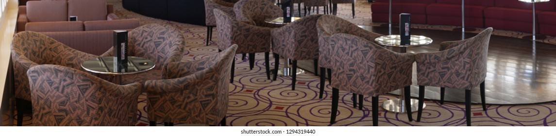 MALAGA, SPAIN - NOV 24, 2018 - Tables and chairs in the lounge of a cruise ship in Malaga, Spain