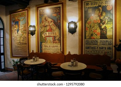 MALAGA, SPAIN - NOV 24, 2018 - Festival posters in the tavern of a winery in Malaga, Spain