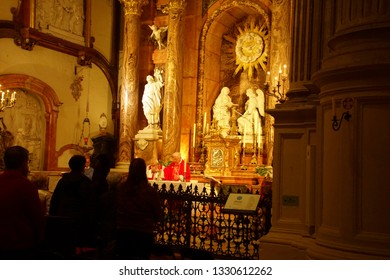 MALAGA, SPAIN - NOV 24, 2018 - Priest celebrating mass in the Cathedral of Malaga, Spain