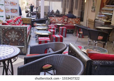 MALAGA, SPAIN - NOV 24, 2018 - Traditional tables and chairs in winery restaurant in Malaga, Spain