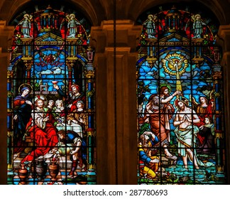 MALAGA, SPAIN - NOVEMBER 29, 2013: Stained glass window depicting Jesus at the Wedding at Cana and Jesus baptized in the River Jordan by Saint John, in the cathedral of Malaga, Spain.