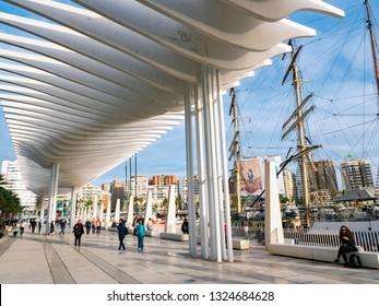 MALAGA, SPAIN - NOVEMBER 29, 2019: Palmeral de las Sorpresas promenade at Malaga port. Costa del Sol, Andalusia