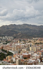 Malaga, Spain - October 20 2012 - An aerial view of Malaga's skyline with a cloudy sky as a backdrop.  Image has copy space.