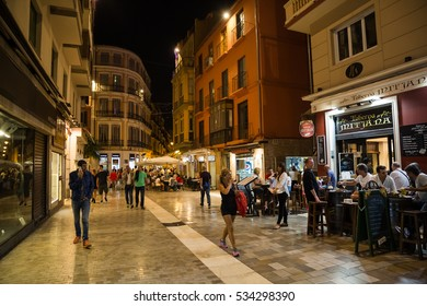 MALAGA, SPAIN - OCTOBER, 2016: Cityscape. View of the street cafe at night with visitors.