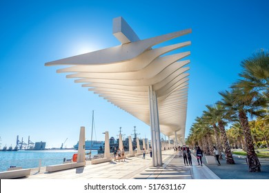 MALAGA, SPAIN - OCTOBER 30,2016: Palmeral de las Sorpresas promenade at port in Malaga. Andalusia, Spain. Many people having fun in sunny day at this place.