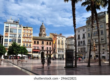 MALAGA, SPAIN - OCTOBER 4:Tourists walk around the historic center of Malaga on October 4, 2014.