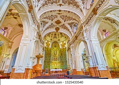 MALAGA, SPAIN - SEPTEMBER 26, 2019: The prayer hall of Santiago Apostol Church, decorated with ornaments of fretwork, gilt details and fine carved altar, on September 26 in Malaga