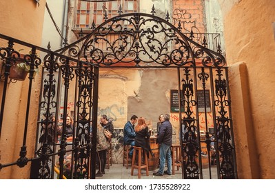 MALAGA, SPAINE: Friendly people meeting for lunch and drinks at outdoor cafe in historical area of city on November 23, 2018. Andalusian city Malaga has population of 600,000 people.