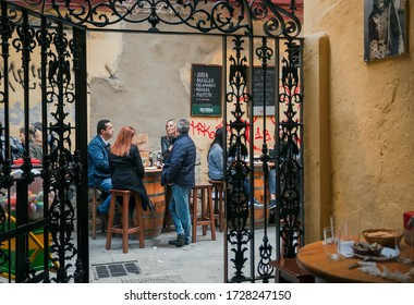 MALAGA, SPAINE: Some women and men having drinks and lunch at outdoor restaurant on old spanish street on November 23, 2018. Andalusian city Malaga has population of 600,000 people.