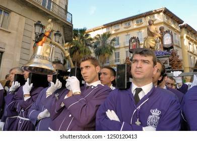 MALAGA, SPAIN-MARCH 23,2016: Costaleros bearing a Tronos during Semana Santa. The Christian Semana Santa procession in Spain is held in the week before Easter.