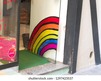 Malaga/Spain - 01-25-2019 : shop entrance with the rainbow colors of the LGBT, red orange, yellow, blue, purple.