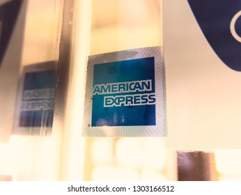 Malaga/Spain - 01-31-2019 : Logo ¨american express¨ on a sticker  on a glass window. There is a reflection of the image that creates a symmetry.