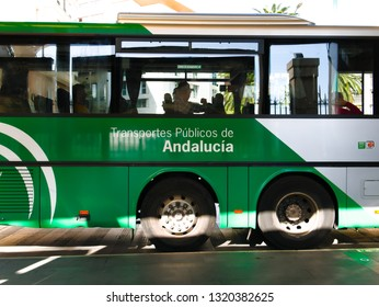 Malaga/Spain - 02-21-2019 : side view of a city bus in Spain, white and green color. It is written ¨public transport of Andalusia¨, Andalusia is a Spanish region.