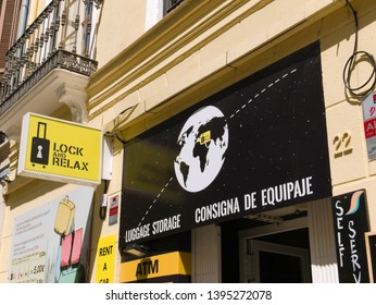 Malaga/Spain - 05-09-2019 :Sign of a luggage storage store. Luggage store is written in english and in Spanish.